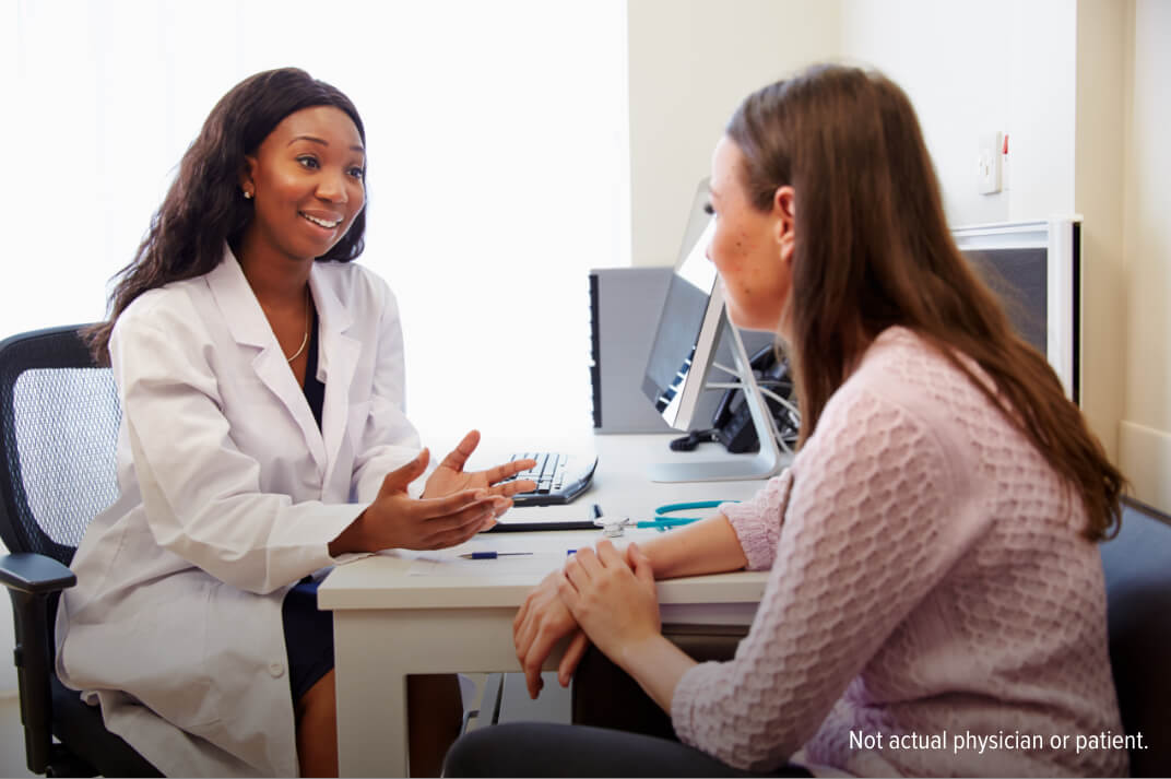 Healthcare professional discussing treatment with a female patient